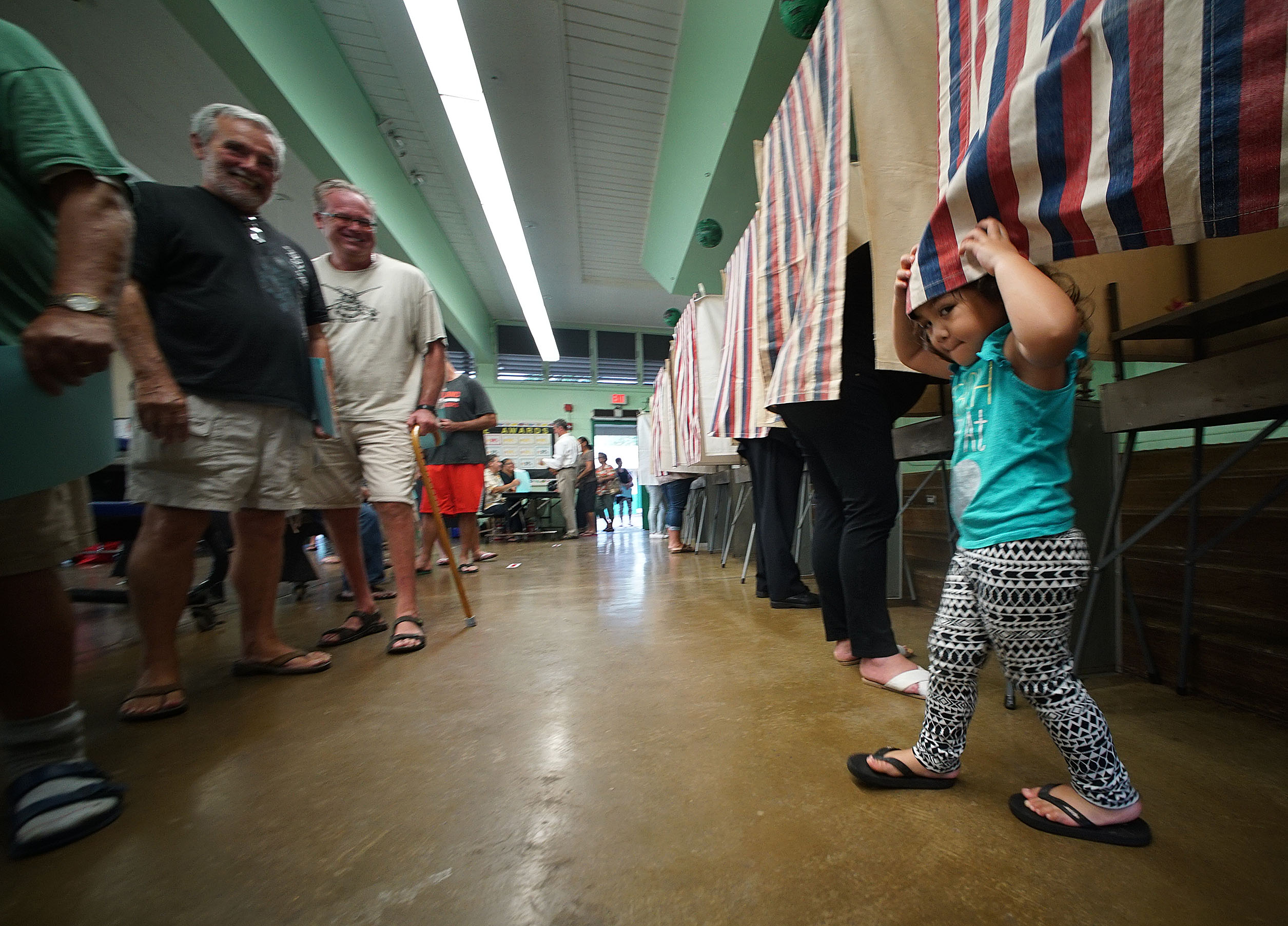 <p>Ireland Tuiono, 2, enjoyed a polling booth while mother Kerrianne Tuiono cast her ballot Hauula Elementary. — Cory Lum/Civil Beat</p>