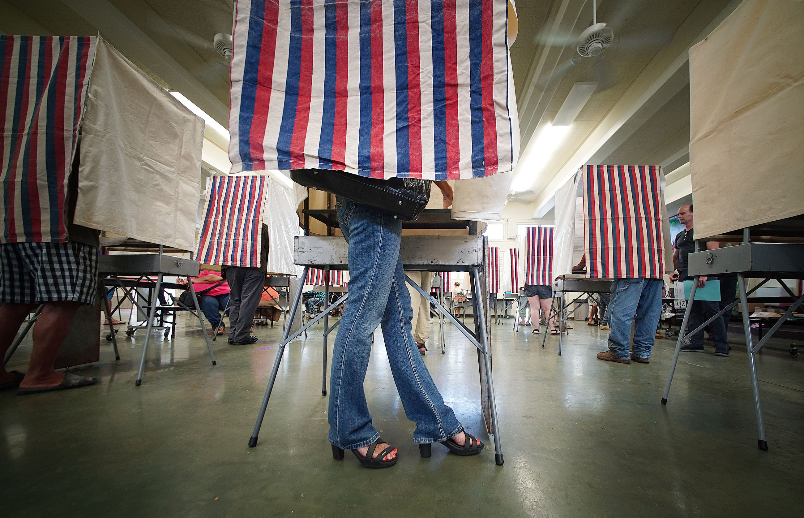 <p>Fashionable shoes brought this early morning voter to the polls at Kahaluu Elementary School. — Cory Lum/Civil Beat</p>