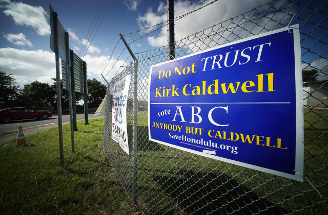 Kirk Caldwell sign along Middle Street along the fence at Fort Shafter base. 1 nov 2016
