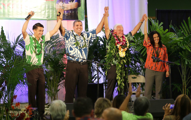 Mayor Kirk Caldwell raises arms in unity with City Council members Brandon Elefante, Ikaika Anderson and Kymberly Pine at Caldwell HQ located at the old Sports Authority on ward avenue. 8 nov 2016
