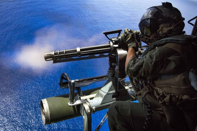 Marine Corps Cpl. Cristina Fuentes fires a GAU-17/A gun during an exercise over Farallon de Medinilla on September 16.