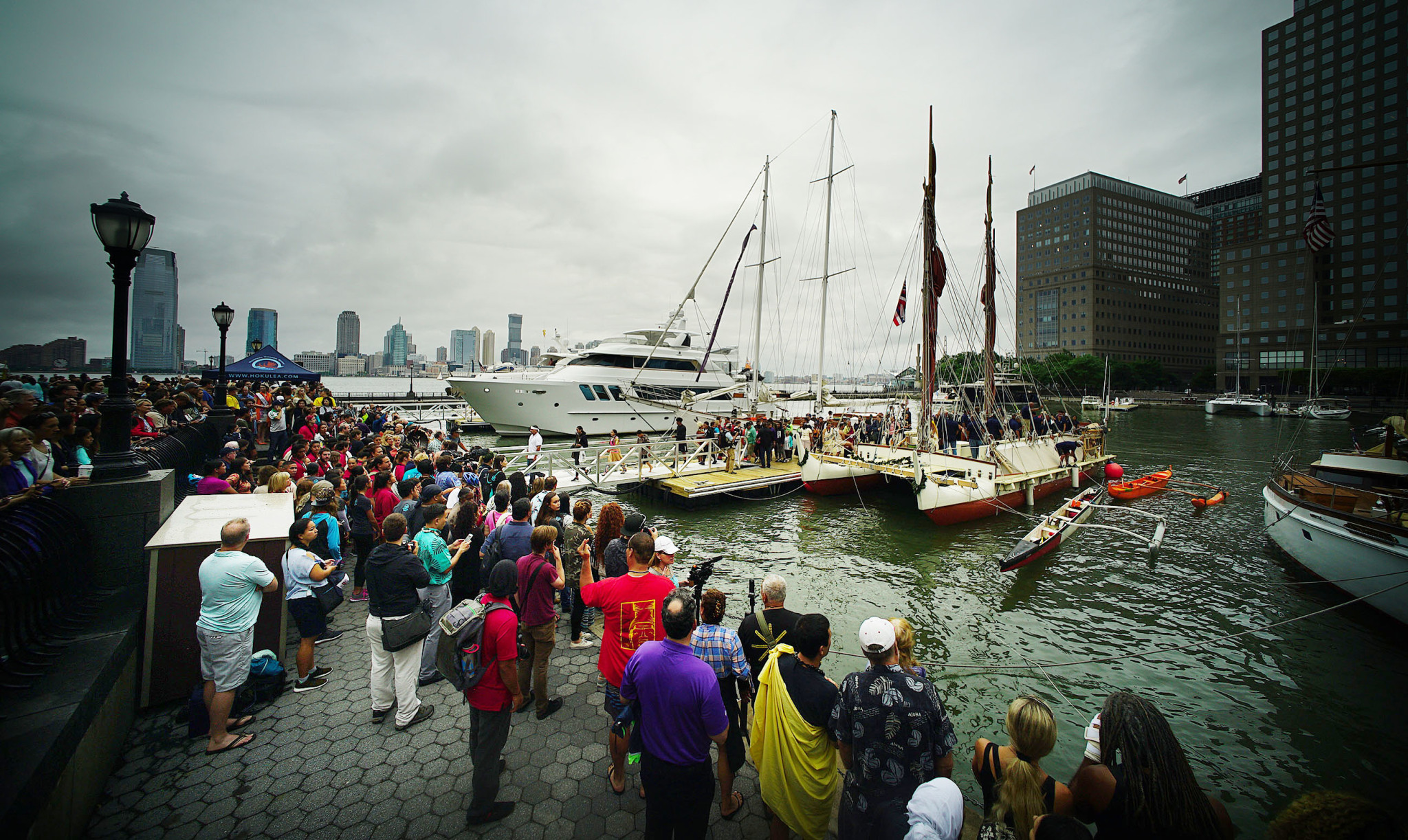 <p>June 5: During its three-year, around-the-world cruise, the double-hulled voyaging canoe Hokulea docks at Manhattan's North Cove Pier as Native American groups sing to greet the crew. <em>Cory Lum/Civil Beat</em></p>