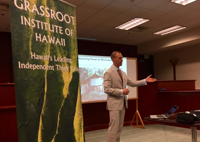 Neil Mellen shared his views on America's role in Micronesia downtown Thursday.