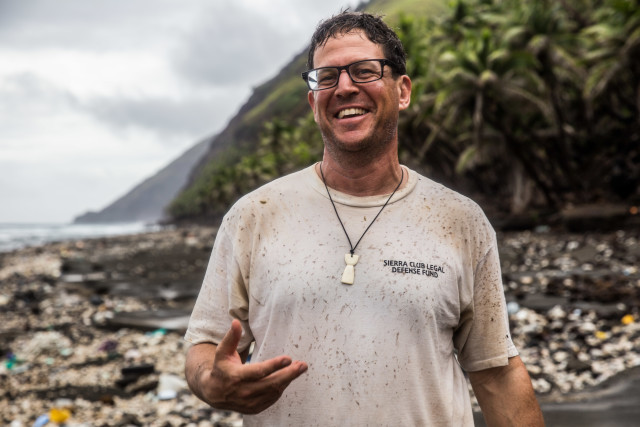 Earthjustice attorney David Henkin stands on a beach on Pagan, which he is suing the Navy to protect from bombing. He also brought a lawsuit to protect whales and dolphins in the waters around Hawaii.