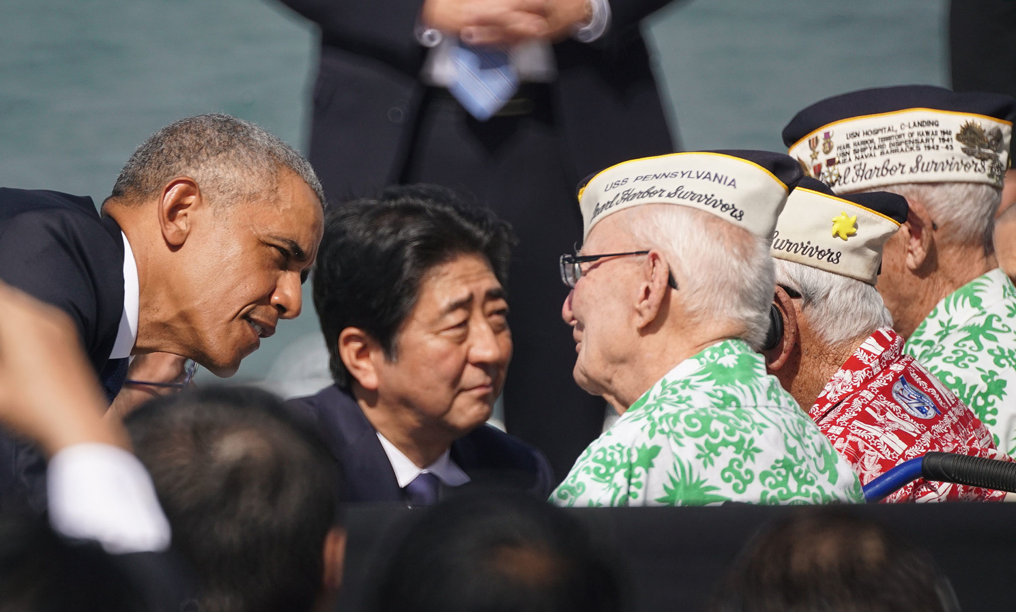 <p>Dec. 27: President Obama and Prime Minister Abe talk with U.S. veterans who survived the attack. Very few are still alive. <em>Cory Lum/Civil Beat</em></p>