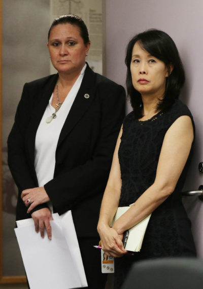 Katherine Kealoha, left, has said she and her husband HPD Chief Kealoha are innocent of any wrongdoing. Kealoha was there in the doorway of the commission meeting for a split second with right, HPD spokeswoman Michele Yu. 7 sept 2016