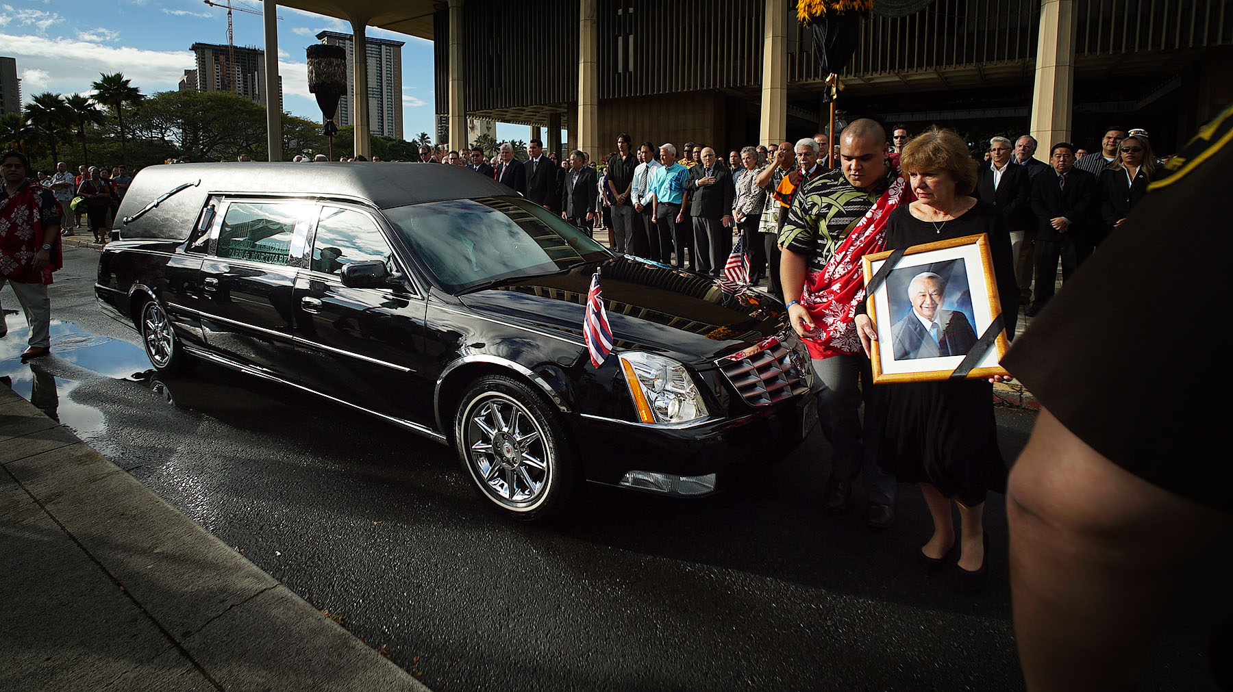<p>Feb. 2: The late Sen. Gil Kahele&#8217;s wife, Linda, watches as a hearse carrying the body of the Big Island legislator reaches the Capitol. <em>Cory Lum/Civil Beat</em></p>