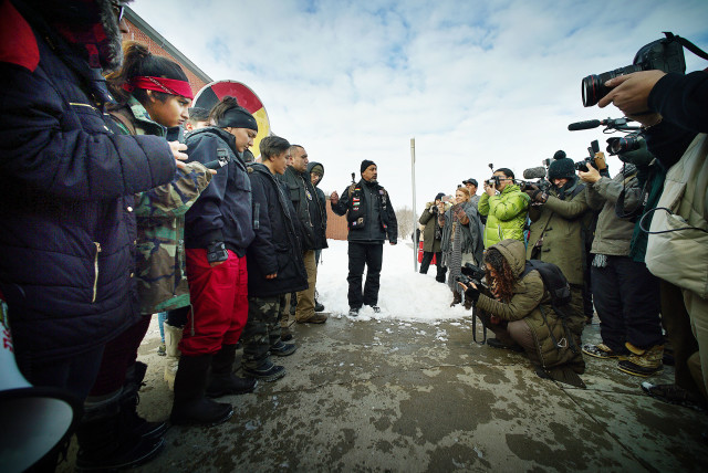 Andre Perez introduces Standing Rock demonstrators fronting the Mandan Police Dept. Mandan, North Dakota. 2 dec 2016