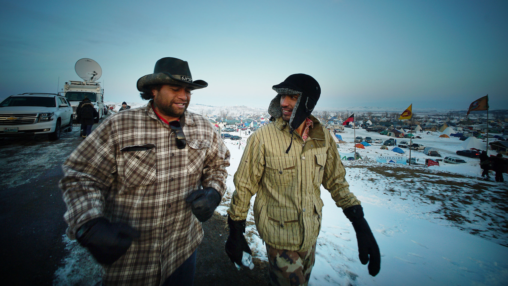 <p>Dec. 3: A number of Hawaii residents joined the thousands of people protesting the Dakota Access Pipeline project near the Standing Rock Sioux reservation in North Dakota, including Michael Kyser Jr., left, and Leomana Turalde. <em>Cory Lum/Civil Beat</em></p>