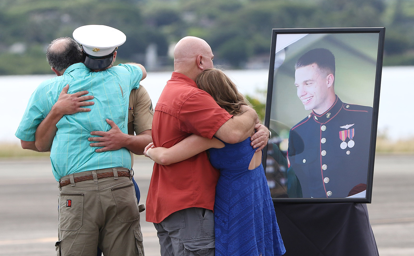 <p>Jan. 22: Family members grieve during memorial services for 12 U.S. Marines killed when two helicopters collided off the North Shore.<em> Cory Lum/Civil Beat</em></p>