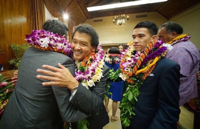 Honolulu City Council Chair Ron Menor Hugged by member Trevor Ozawa as councilmember Elefante looks on. 3 jan 2017