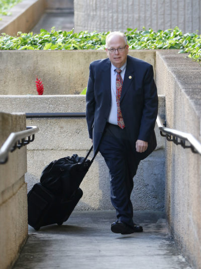 Federal Special Prosecutor Michael Wheat walks up ramp to the Federal Building. Honolulu. 12 jan 2017