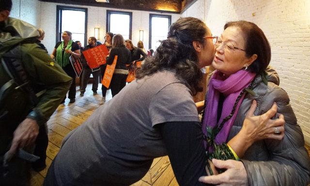 Hilo resident Jennifer Kagiwada gives Sen Mazie Hirono a ti leaf lei before march at Stanton and Greene. Washington DC. 21 jan 2017