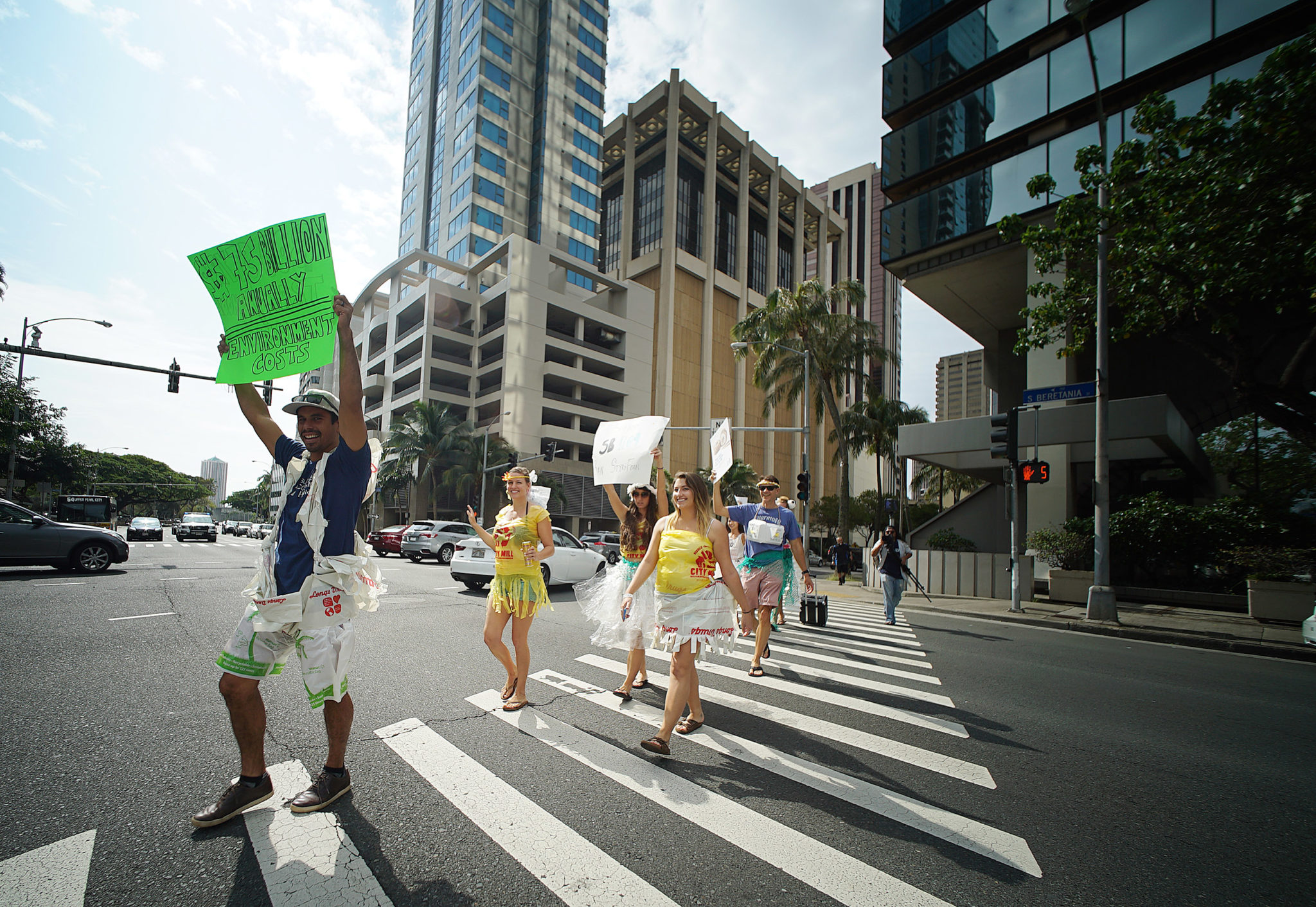 <p>The protesters marched up Bishop Street on their approach to Longs Drugs, one of the companies that now uses thicker plastic bags that are exempt from the current Oahu ban.</p>