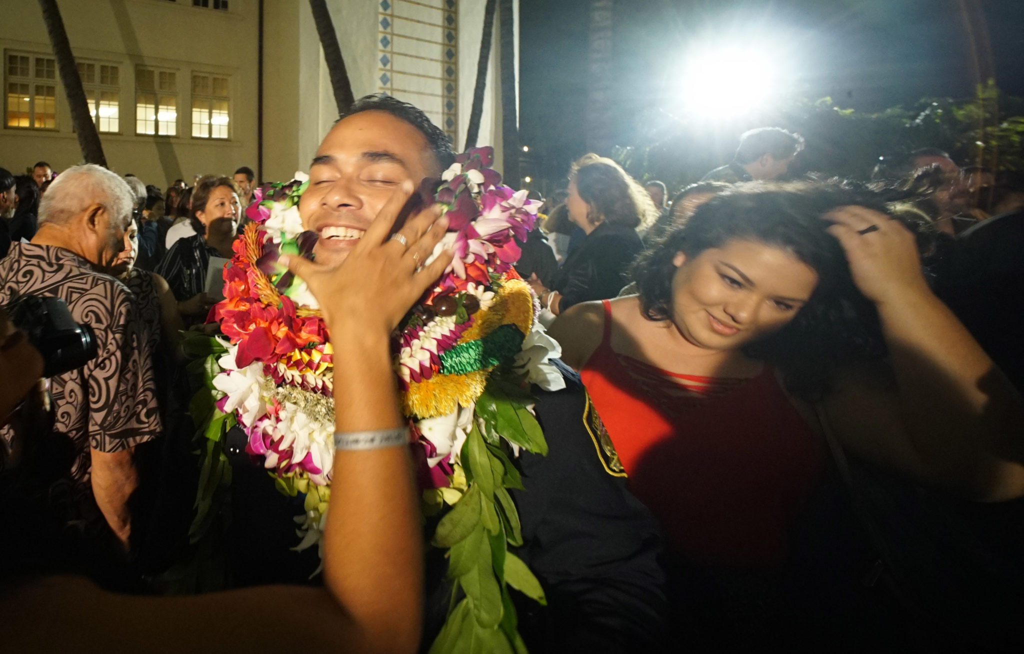 <p>Graduate Adam Ruiz got some help with his leis after becoming one of Honolulu&#8217;s newest police officers.</p>