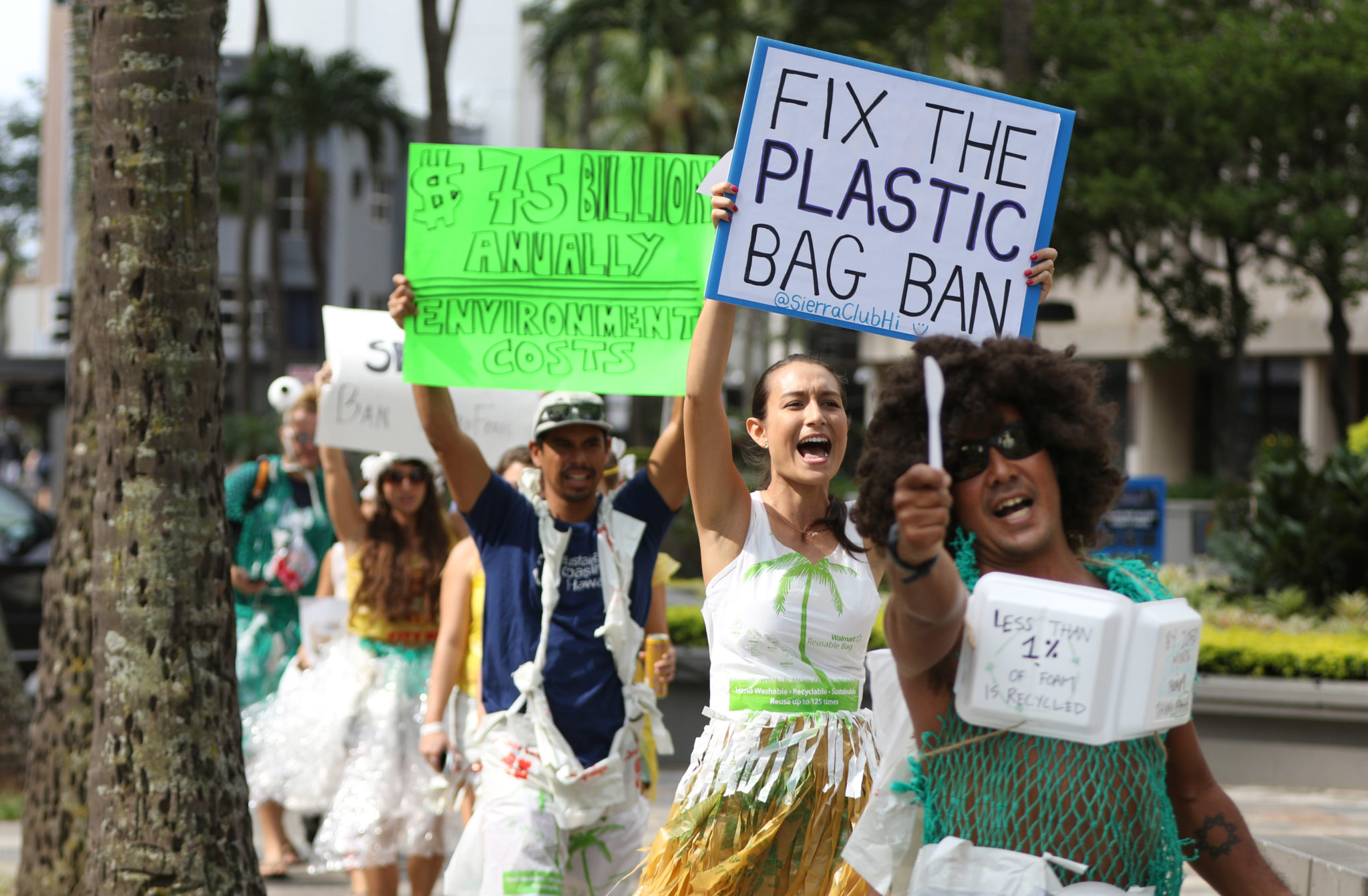 Aaron Char leads supporters march along Bishop Street towards Pali Longs Drugs to encourage the City to close the loophole in the plastic bag ban and the State to pass a ban on syrofoam food containers. 10 feb 2017