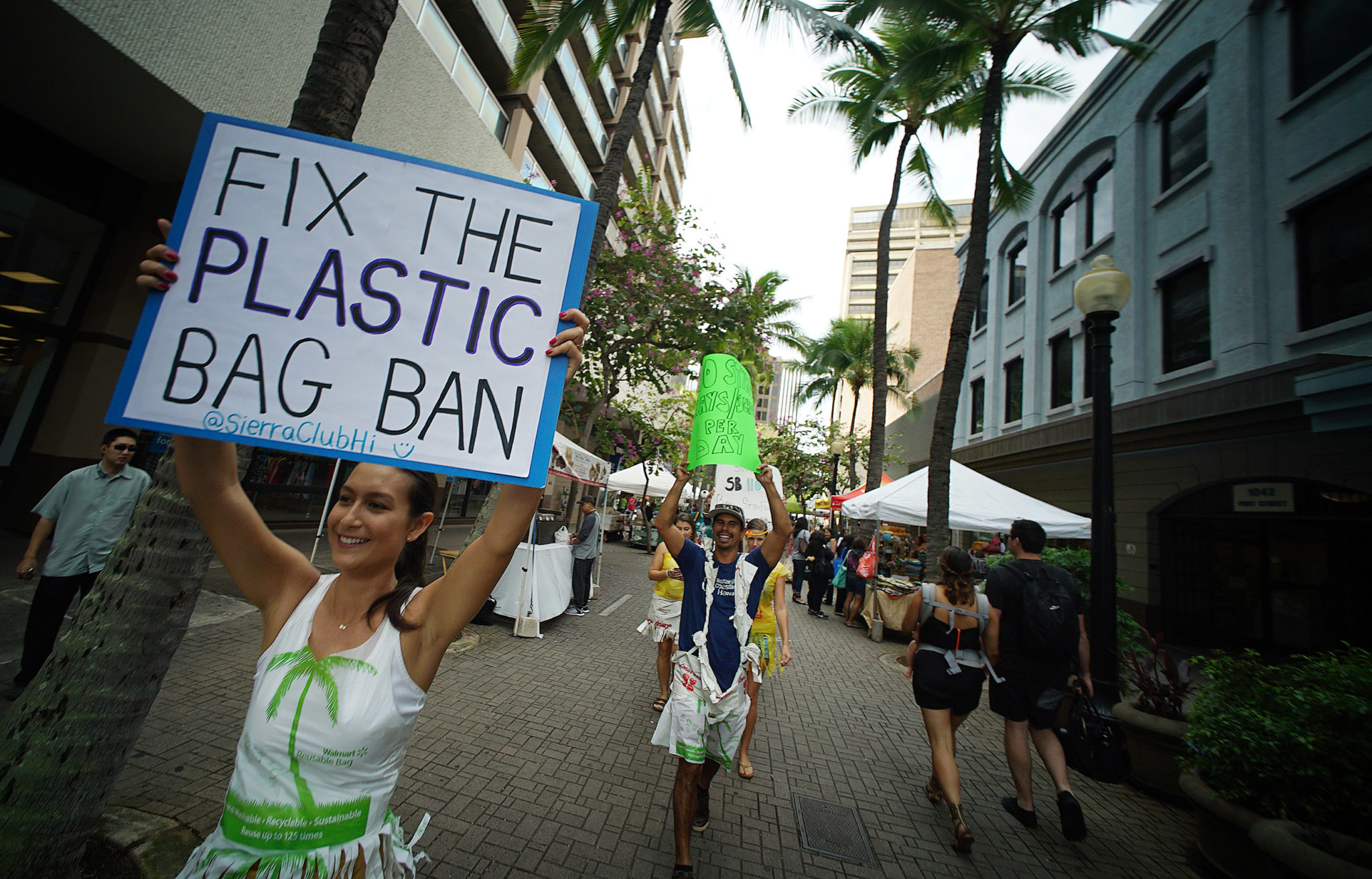 <p>Jodi Malinoski led the marchers through the Fort Street Mall. A state Senate bill would ban plastic foam food containers in all counties that lack a polystyrene foam container recycling program.</p>