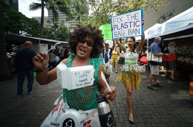 Aaron Char leads marchers up Fort Street Mall towards Pali Longs Drugs to encourage the City to close the loophole in the plastic bag ban and the State to pass a ban on syrofoam food containers. 10 feb 2017