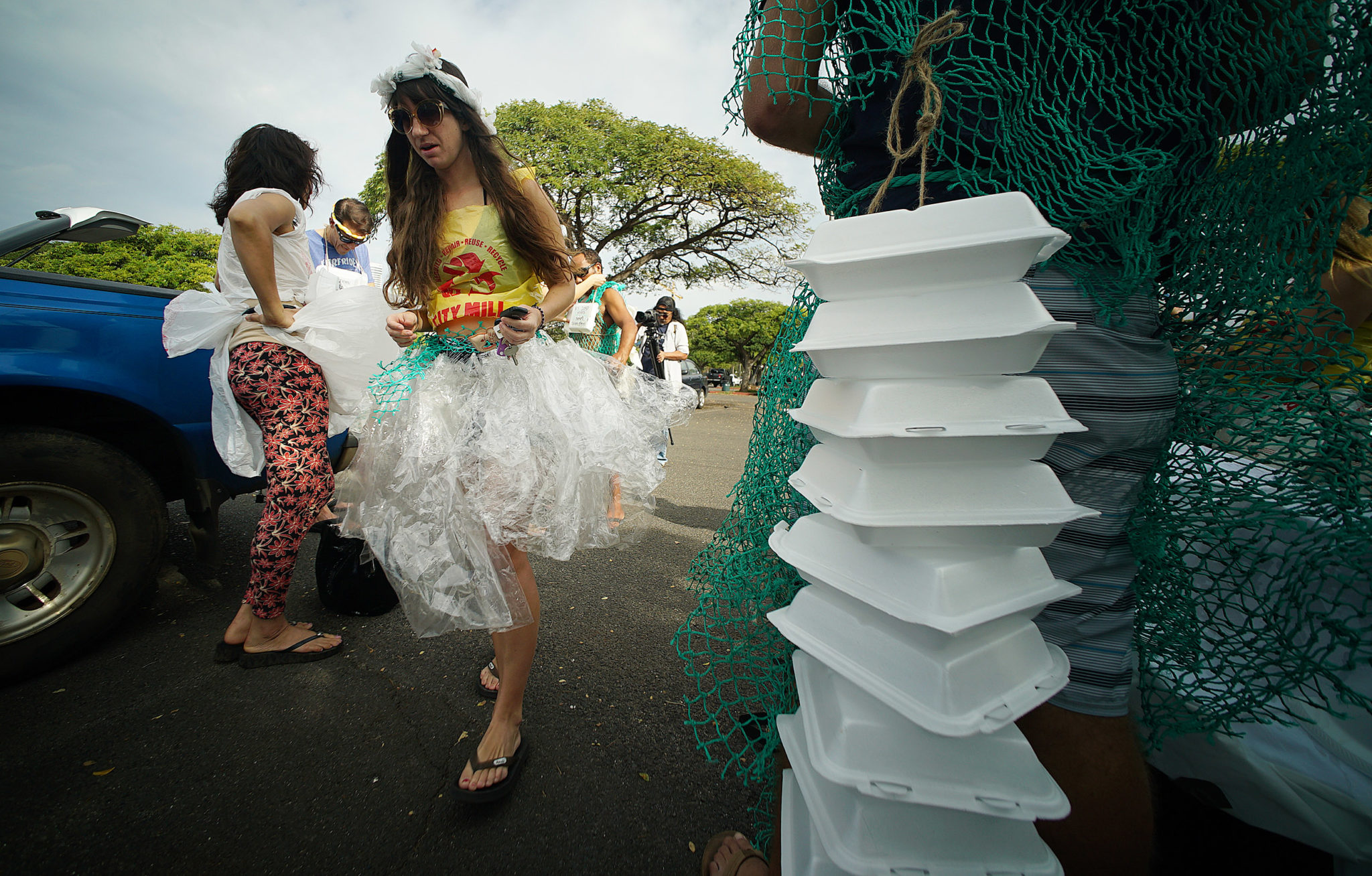 <p>Final wardrobe adjustments were made at Magic Island before protesters headed by bus toward the Longs Drugs on Pali Highway.</p>