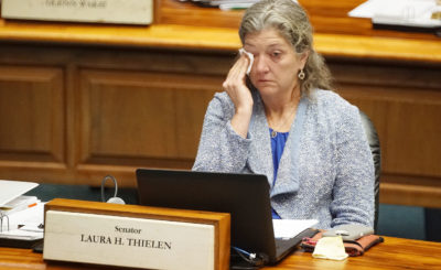 Senator Laura Thielen wipes away tears after Senator Harimoto shared his first hand experience looking at death in the face during floor discussions on the death with dignity measure. 7 march 2017