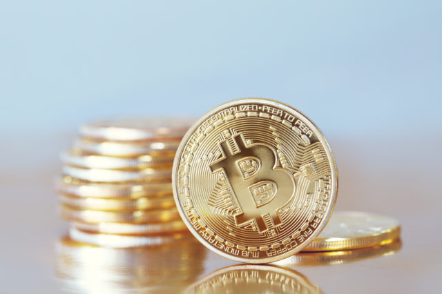 Prague, Czech Republic - January 1, 2000: Studio shot of Bitcoin coin .Symbol of a new virtual currency .