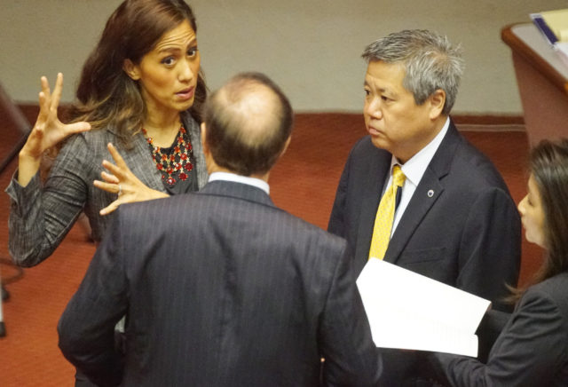 House Minority Leader Andria Tupola speaks to Rep Saiki, Rep Luke and Rep Ward before floor session gaveled in. 11 april 2017