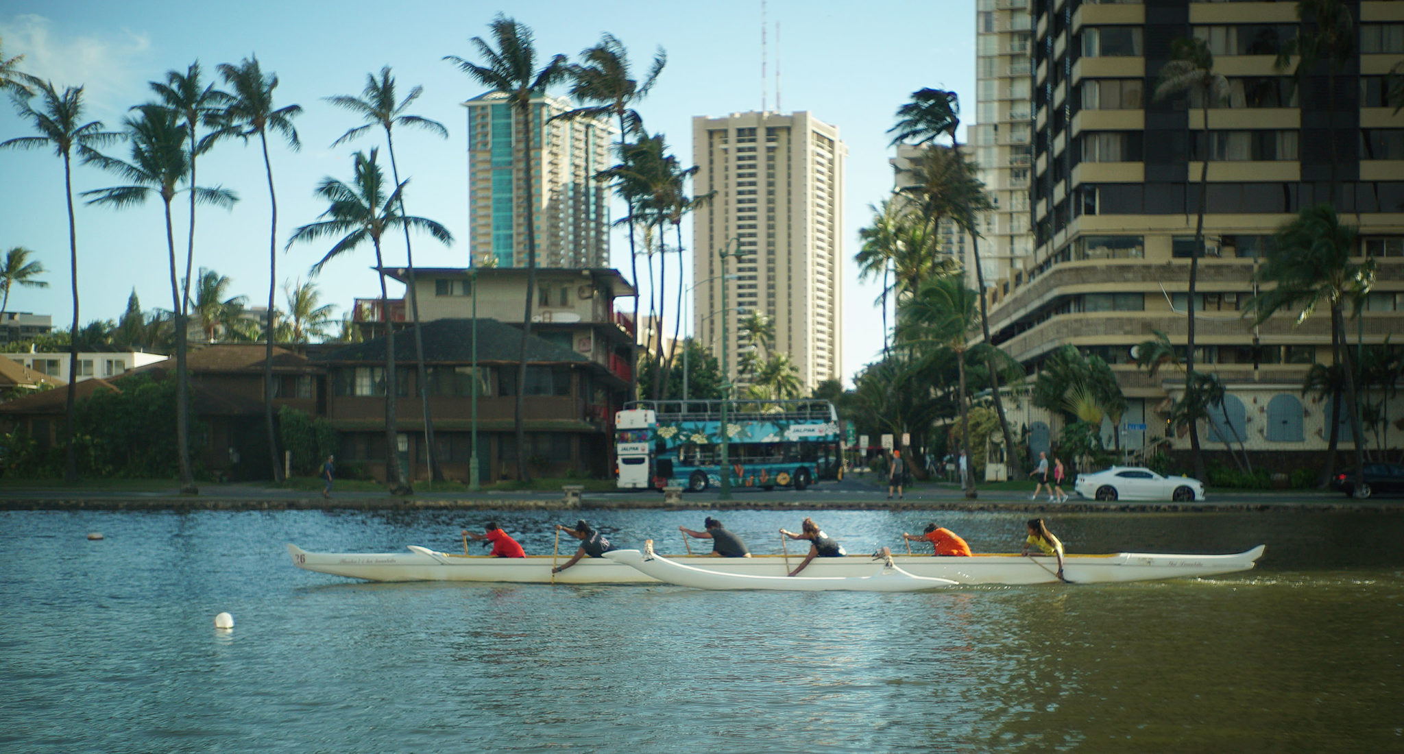 <p>Canoe paddlers on the Ala Wai Canal ride a little higher than usual Thursday with the water only about a foot below the top of a retaining wall.</p>