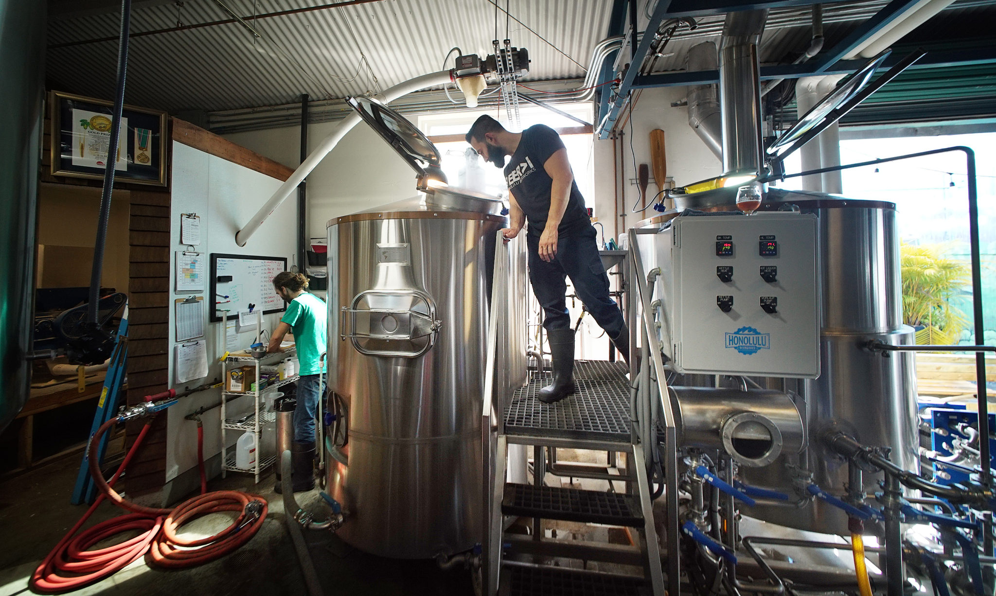 <p>Ken Caldwell keeps an eye on the mash tun vessel. Mashing converts starches from the malt into sugars for fermenting at the brewery, which was opened in 2014 by Geoff Seideman and his wife, Charmayne.</p>