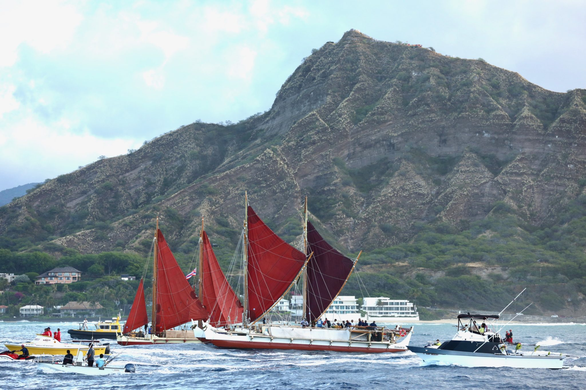 <p>Hokulea passes Diamond Head as its three-year voyage around the world nears its conclusion Saturday morning. / Anthony Quintano</p>