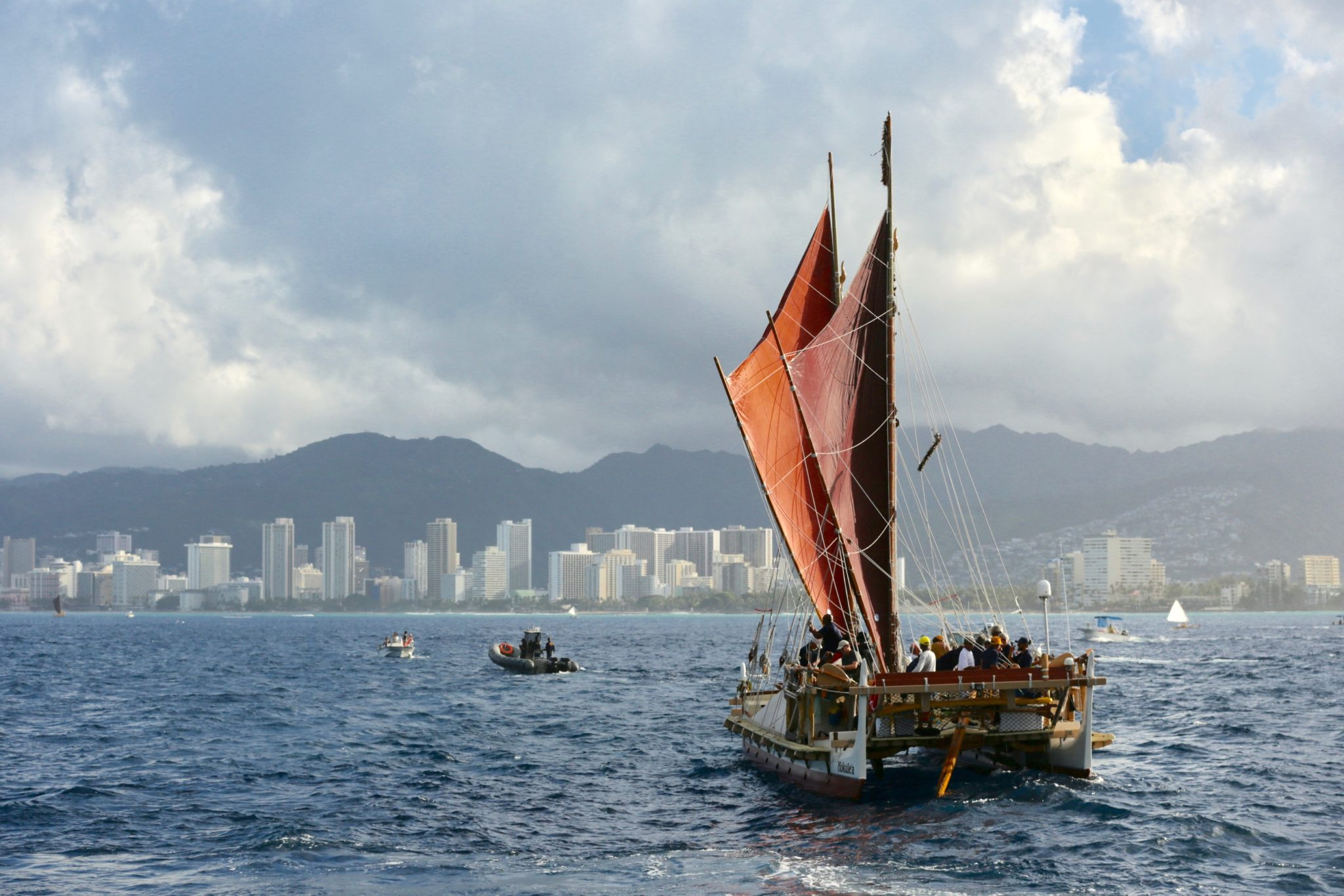 <p>The Hokulea crew opens her sails to make the final push toward Magic Island. / Anthony Quintano</p>