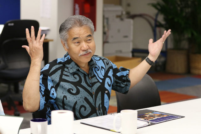 Governor David Ige gestures during Editorial board meeting at the Civil Beat office.