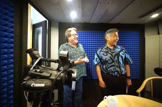 Governor David Ige checks out our whisper room with Chad Blair before podcast Honolulu Civil Beat