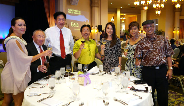 Center. Senator Glenn Wakai toasts with right, Senator Will Espero at Hawaiis Forgotten Families Foundation Gala event held at the Royal Hawaiian Hotel Monarch Room.