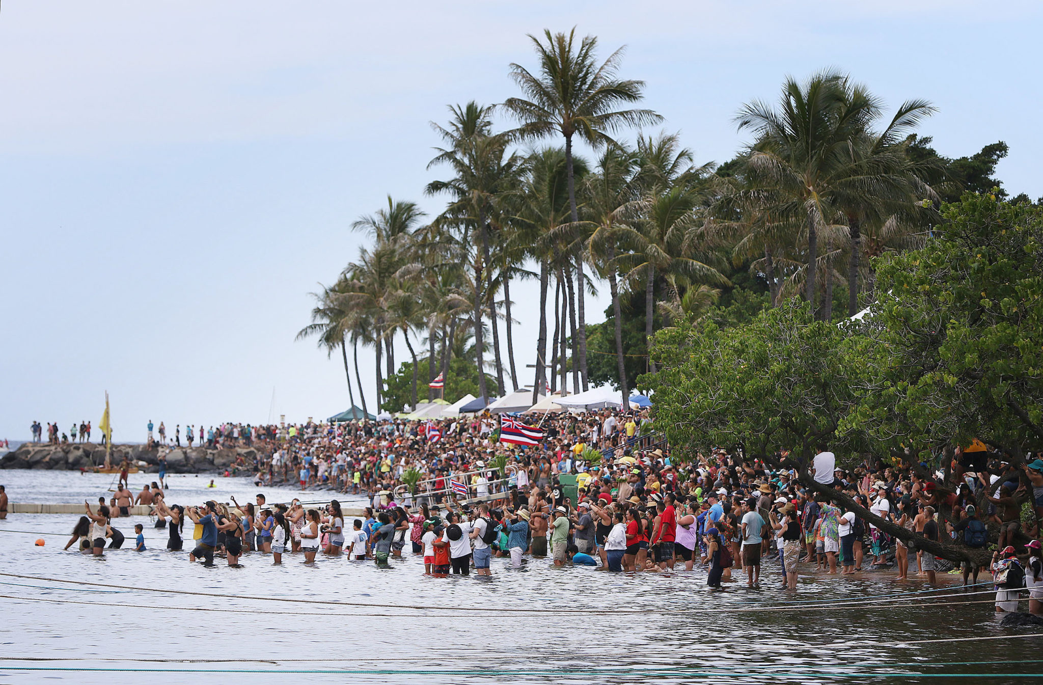 <p>Thousands of people mass on the shore at Magic Island to greet the Hokulea. / Cory Lum</p>
