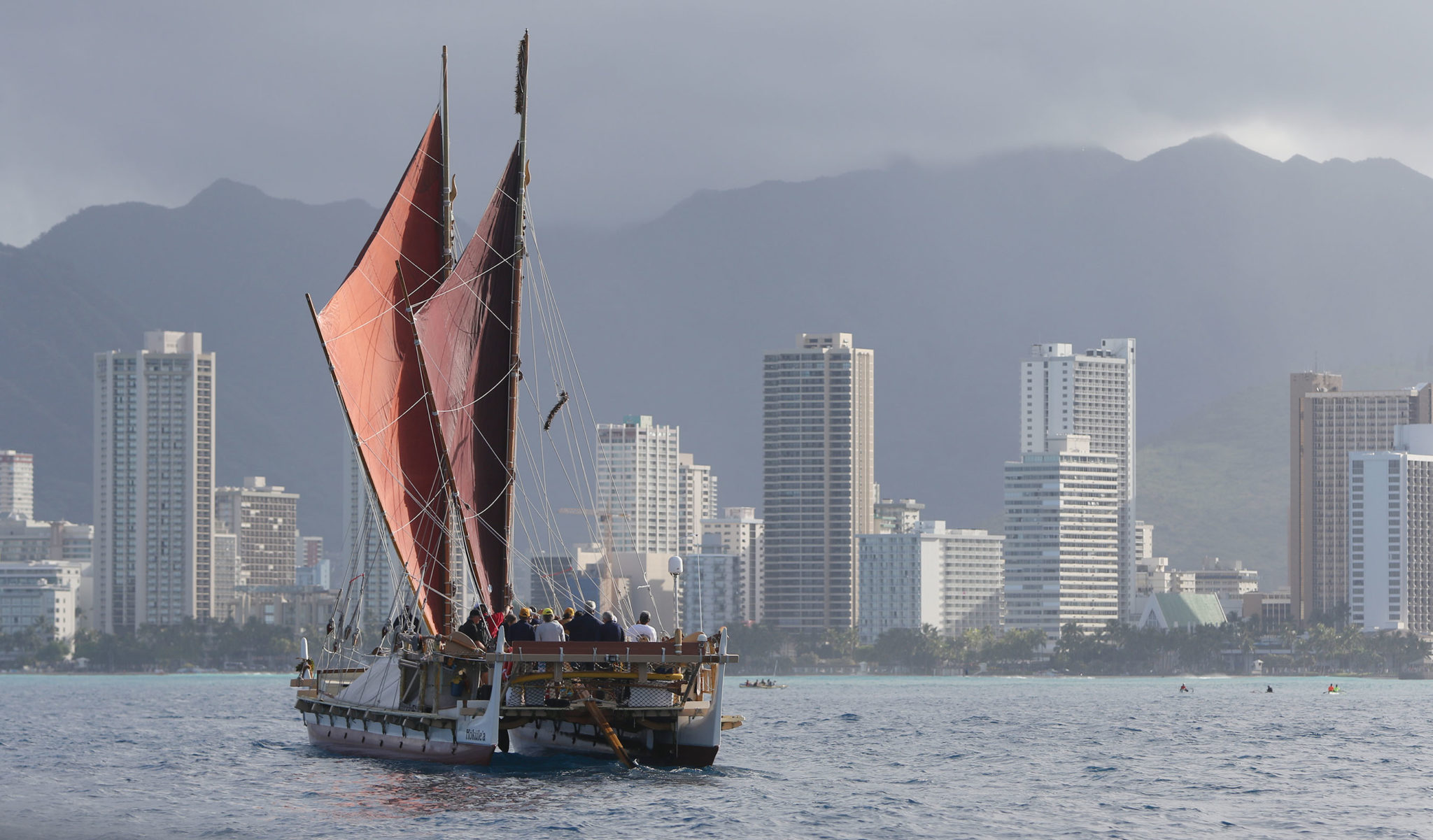 <p>The HokulHokulea sails offshore Waikiki on her way to Magic Island after a 3 year around the world voyage.ea crew opens her sails to make the final push toward Magic Island. Cory Lum/Civil Beat</p>