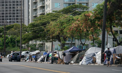 Tents line Iwilei Road near Salvation Army Building where city is sweeping adjacent state properties. 5 june 2017