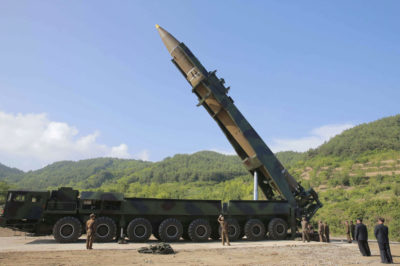 """FILE - In this July 4, 2017, file photo distributed by the North Korean government, North Korean leader Kim Jong Un, second from right, inspects the preparation of the launch of a Hwasong-14 intercontinental ballistic missile (ICBM) in North Korea's northwest. Hawaii is the first state to prepare the public for the possibility of a ballistic missile threat from North Korea. The state's Emergency Management Agency on Friday, July 21, 2017 announced a public education campaign. Agency Administrator Vern Miyagi says because it would take a missile about 15 minutes to arrive, there won't be much time to prepare. He says that's why instructions are simple: """"Get inside, stay inside and stay tuned."""" (Korean Central News Agency/Korea News Service via AP, File)"""