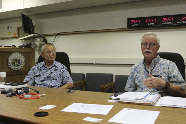 Hawaii Emergency Management Agency Administrator Vern Miyagi, left, and Toby Clairmont, the agency's executive officer, discuss a new public education campaign about the missile threat from North Korea in Honolulu on Friday, July 21, 2017. Hawaii is the first state to prepare the public for the possibility of a ballistic missile strike from North Korea. (AP Photo/Jennifer Sinco Kelleher)