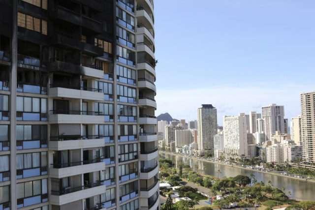 In this July 27, 2017 photo, fire damage is shown at the Marco Polo residential high-rise in Honolulu. The building, where three people died in a recent fire, did not update its fire alarm system to meet the latest safety standards. City records obtained by The Associated Press show no upgrades were made after an engineering firm recommended them after another fire four years ago. (AP Photo/ Cathy Bussewitz)