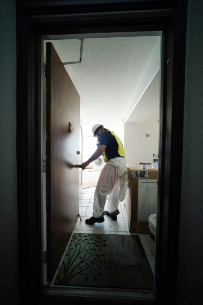 Mike Webb from FloodPro enters a unit on the 12th floor of the Marco Polo that sustained water and other damages.