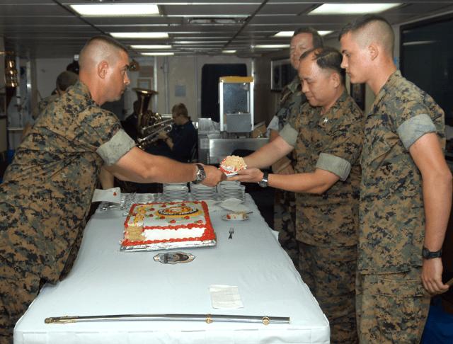 Rick DeGuzman, center right, honored by shipmates on USS Blue Ridge, 2004