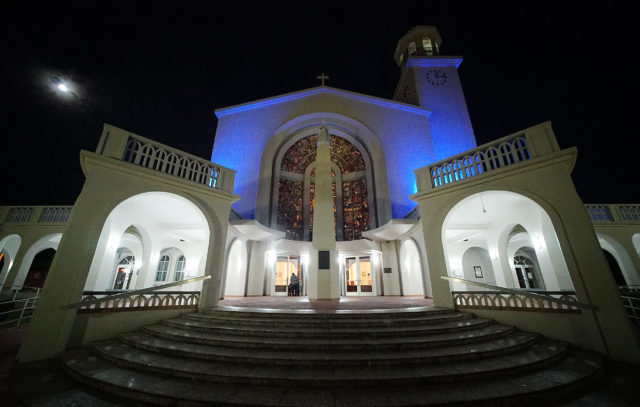 Moon sets over the Guam Hagatna Cathedral before 545am mass.