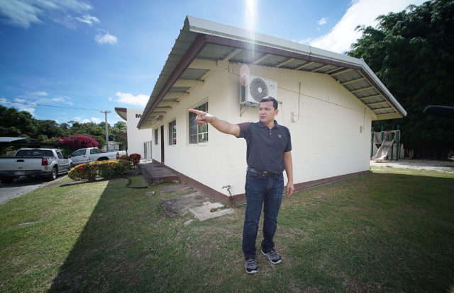 Roy Quintanilla stands outside the former Father Anthony Apuron's living quarters where Quintanilla alledges Apuron sexually assaulted him in the corner room. Hagat, Guam.