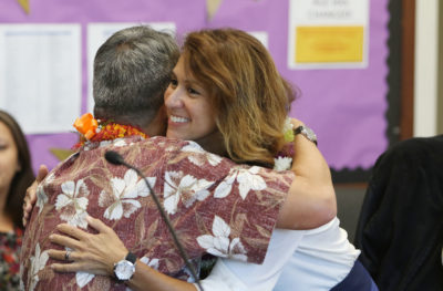 Hawaii Education Superintendent Christina Kishimoto Board of Education hugs from member Nolan Kawano.