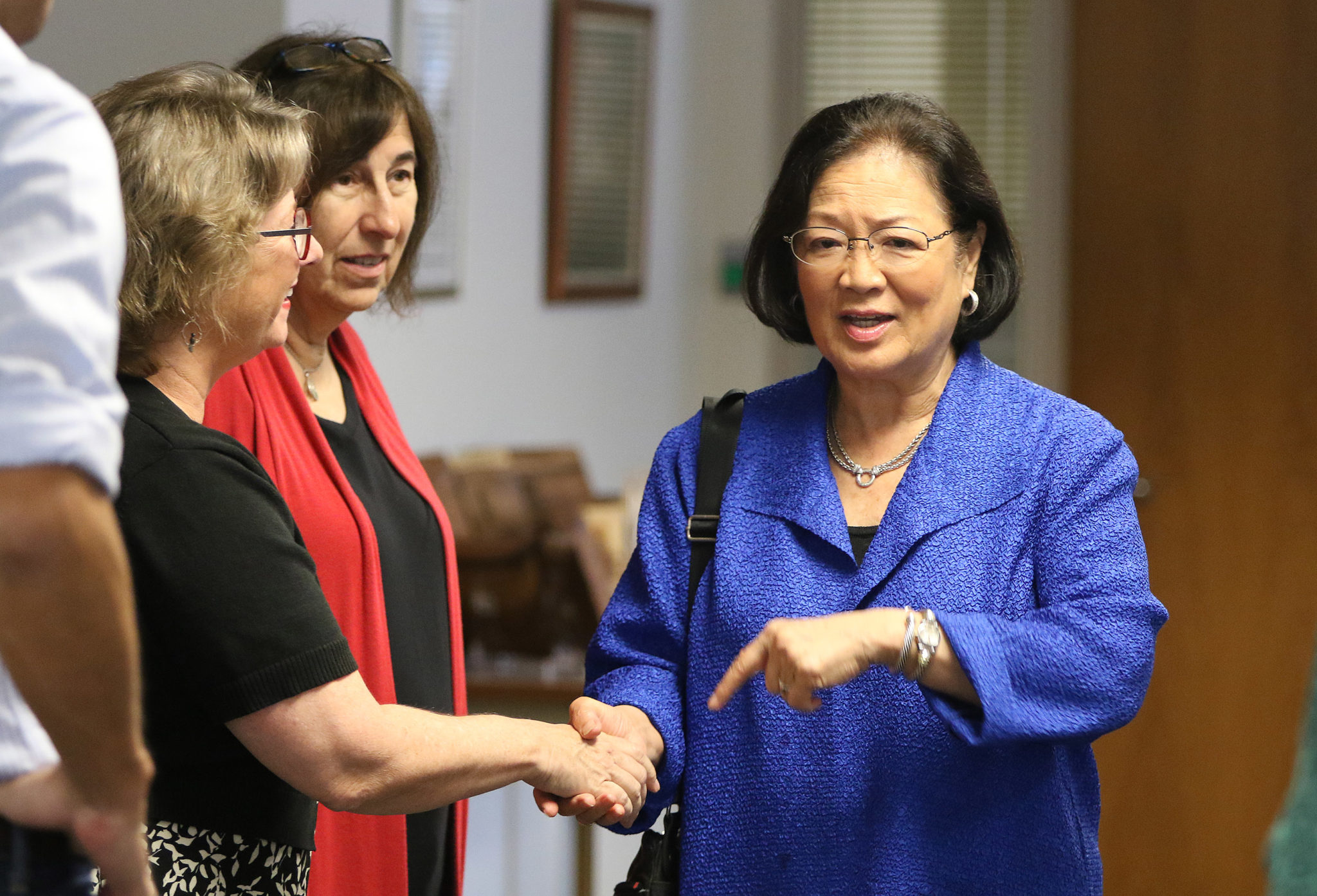 Senator Mazie Hirono greets Civil Beat staffers before her editorial board meeting.