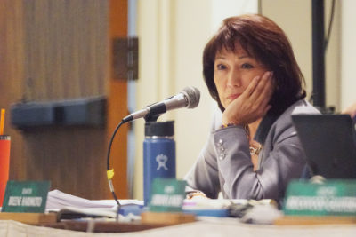 WAM Senator Donna Mercado Kim listens to HART officials testimony during legislature extended session held at the Capitol auditorium.