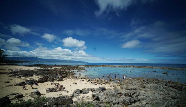 Visitors enjoy swimming at Sharks Cove, Pupukea. North Shore.