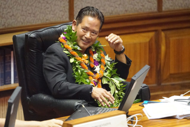 Rep Marcus Oshiro bedecked with lei on the last day of extended session.