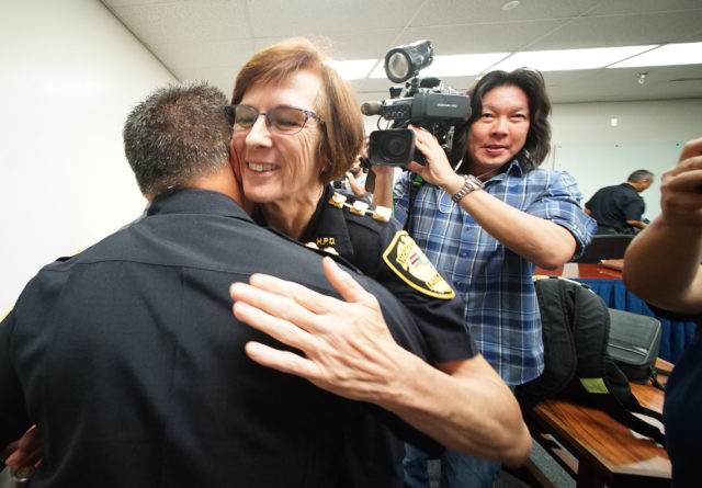 Major Susan Ballard next HPD Chief is hugged by HPD colleagues after the police commission announcement at HPD headquarters.