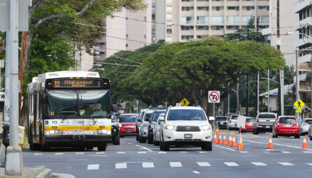Cars stopped on Kapiolani Boulevard at the McCully Intersection. Ewa bound vehicles are not permitted to make the left to waikiki at McCully street.